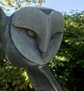 'Spirit' bronze sculpture of an owl by artist and Talos team member Matt Duke looking amazing in the garden
