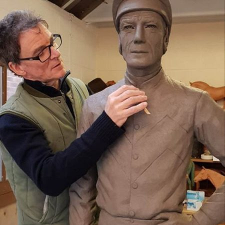 William Newton making final adjustments to his new commission of a very famous jockey before moulding started today. Any guesses who this jockey is?