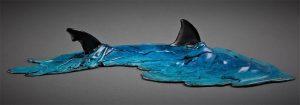 predatory shark cruising in shallow aquamarine waters - Adrian Flanagan