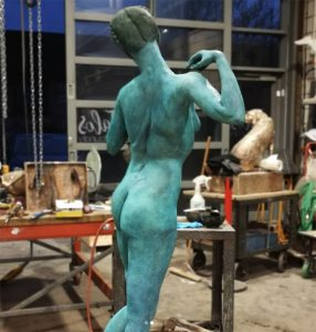 Blue Patina on Life-size female figure by Andrew Freindin