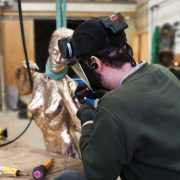 Pat working on a life size female figure by artist Andrew Freidin