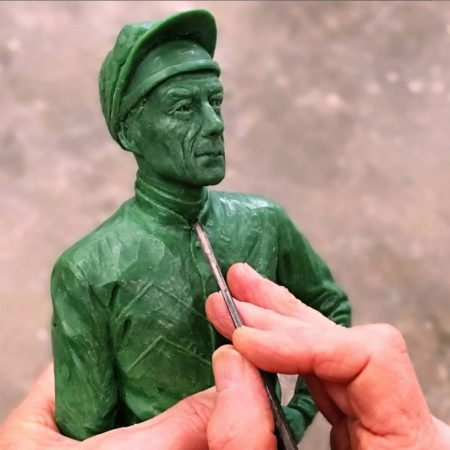 William Newton working on wax maquette of Lester Piggott