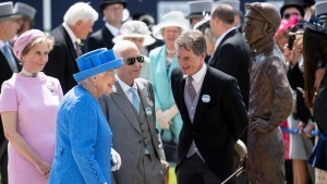 HRH The Queen in blue hat and coat with jockey Lester Piggott and sculptor Willy Newton
