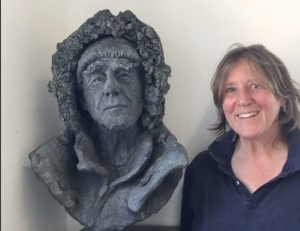 Melanie Legge with her bust of Sir Ranulph Fiennes